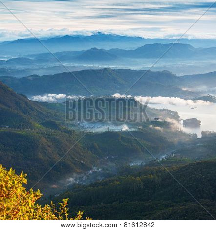 Valley view with villages and mountains at sunrise. View from Adam's peak, Sri Lanka