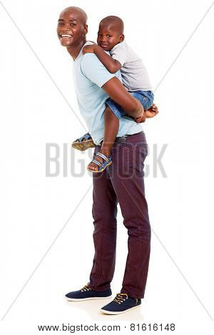 lovely african father giving his son piggyback ride on white background