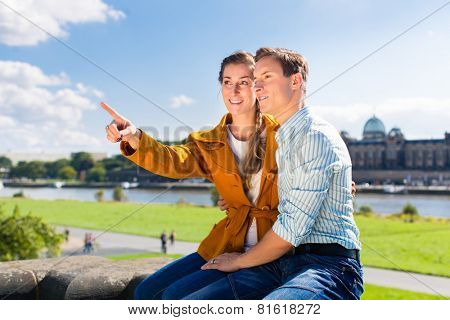 Tourist couple, Man and woman, in Dresden at Elbe riverbank