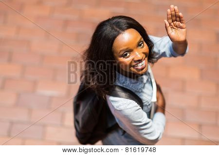 overhead view of african american student waving goodbye
