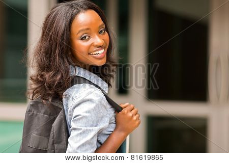beautiful young african college girl carrying backpack