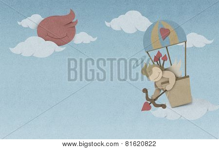 Cupid Shoot Bow In Hot Air Balloon On Sky Made From Recycled Paper