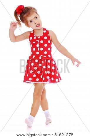 Charming little girl is going briskly.