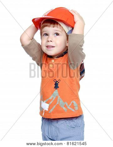 Beautiful little boy on the head to keep