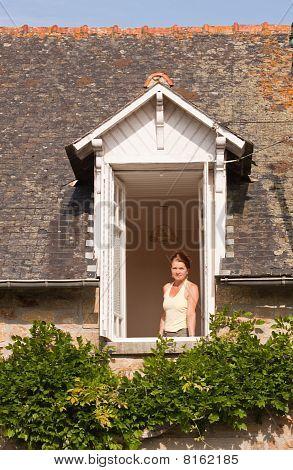 Lady In The Bedroom Window