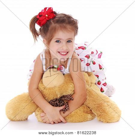 Adorable little girl teddy bear in hand