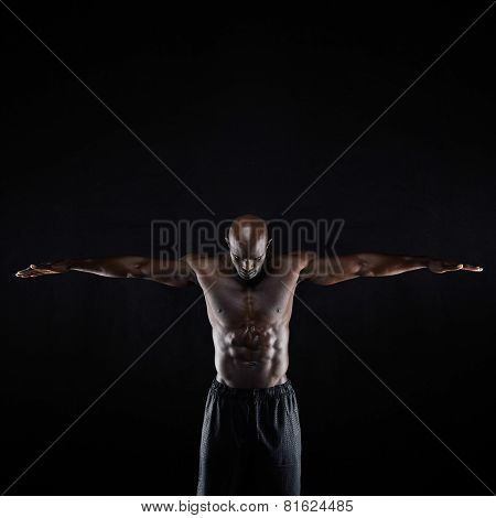 Fit Young Muscular Man Stretching His Arms