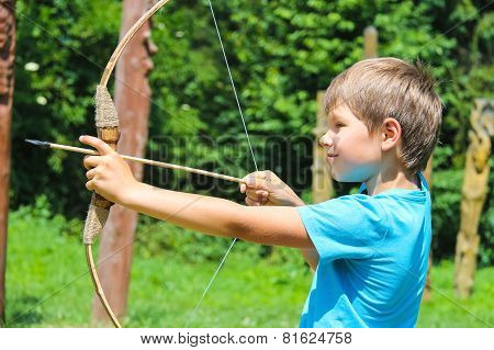 The Kid Shoots A Bow In The Park
