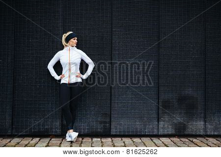 Determined Woman Resting After Jogging In The City