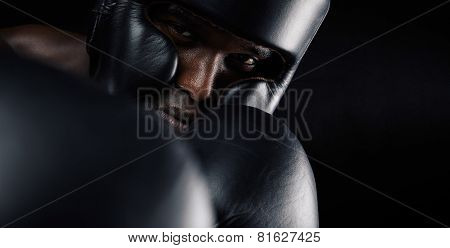 Close-up Of African Male Boxer Exercising