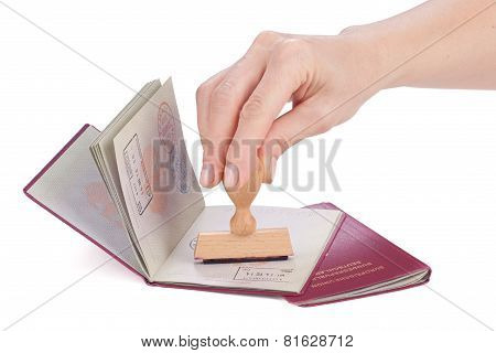 Female Hand Stamping A Passport Of Germany