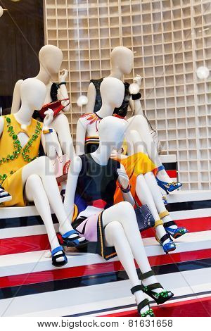Dummies in a show-window of shop of fashionable clothes