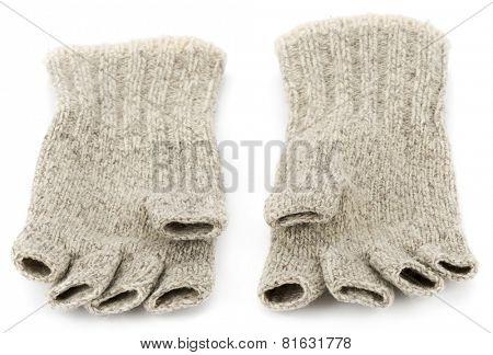 Wool fingerless gloves isolated on white background.