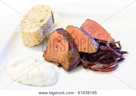 Fried ostrich liver with bread and cabbage.