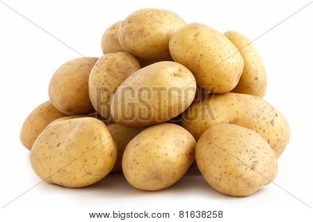 Pile of potatoes arranged on white surface.
