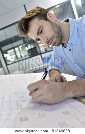 Architect designing on drafting table