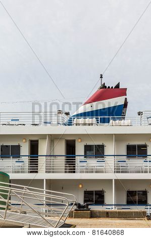 Red White And Blue Smokestack On Small Cruise Ship