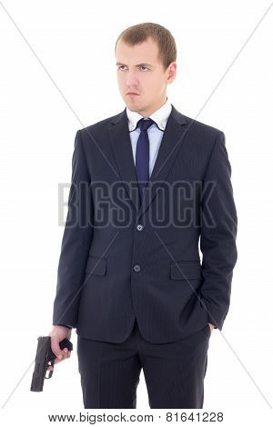 Young Man In Business Suit With Handgun Isolated On White
