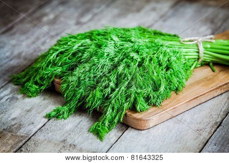 Bunch Of Fresh Organic Dill On  Wooden Background