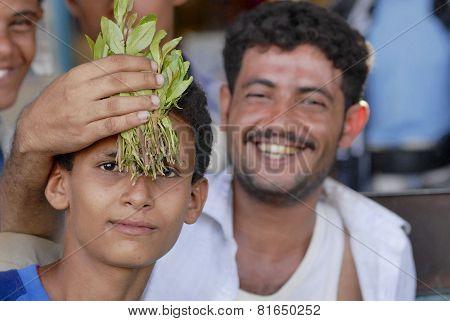 Men sell khat at the local market in Lahij, Yemen.