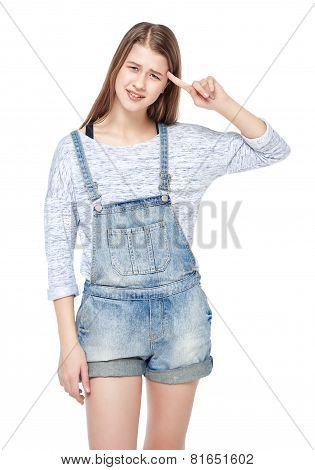 Young Fashion Girl In Jeans Overalls Making Crazy Gesture Isolated