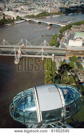 London, United Kingdom - September 24, 2006: Hungerford Bridge Golden Jubilee Bridges Waterloo Bridge over River Thames seen from London Eye ferris wheel