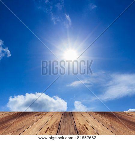 Wood Floor, Blue Sky With Cloud And Sun