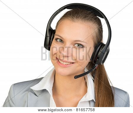 Businesswoman in headset, looking at camera