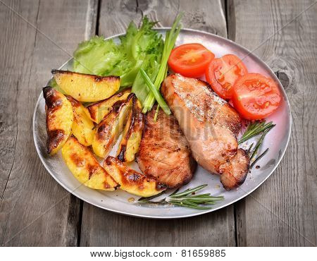 Grilled Pork Chop With Baked Potatoes