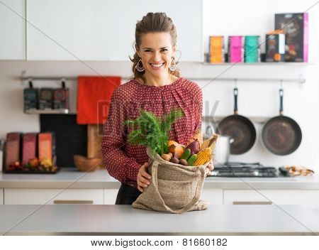 Portrait Of Happy Young Housewife With Local Market Purchases In