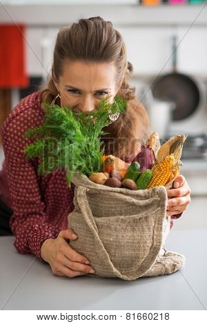 Happy Young Housewife Hiding Behind Fresh Dill From Local Market