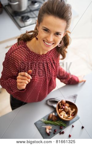 Portrait Of Happy Young Housewife With Plate Of Mushrooms
