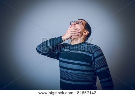male of European appearance brunet covered his mouth with