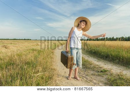 Teenage Hitchhiking On Country Road