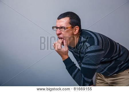 male of European appearance causes vomiting putting his fingers