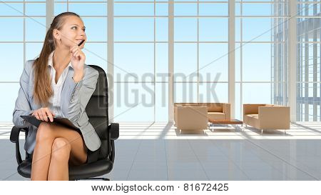 Businesswoman in headset, interior with transparent wall
