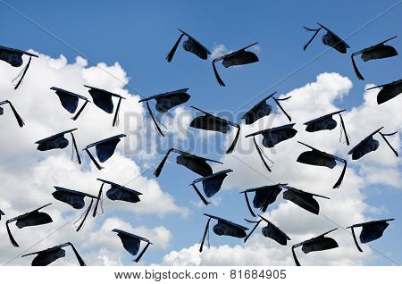 black graduation caps in sky