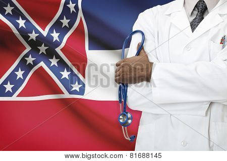 Concept Of National Healthcare System - Mississippi flag on background