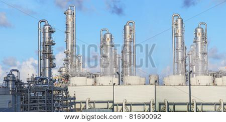 Exterior Of Oil Refinery Chimney Tube Building  In Heavy Petroleum And  Petrochemical Industry