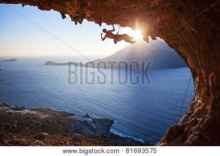 Male rock climber at sunset