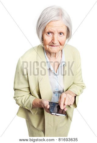 Senior woman holding mobile phone over white