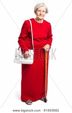 Senior woman with walking stick standing on white