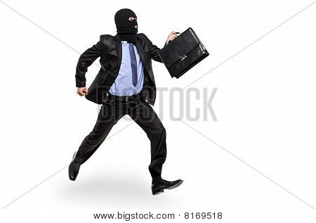 A burglar with robbery mask running away