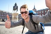 stock photo of selfie  - young attractive student backpacker tourist taking selfie photo with mobile phone outdoors enjoying holidays travel destination in tourism and exploring concept - JPG
