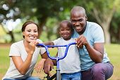 foto of afro  - adorable afro american family having fun together outdoors - JPG