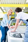 foto of scratch  - Male mechanic examine car finish on dents or scratches in workshop  - JPG