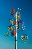picture of wind wheel  - Public artwork of a tree made of colorful wheels - JPG