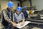 stock photo of industrial safety  - Industrial people meeting together in factory - JPG
