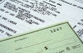 pic of insurance-policy  - This is an image of an automobile insurance policy and personal check - JPG