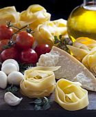 picture of italian food  - Italian food ingredients including pasta mozzarella tomatoes parmesan olive oil garlic and herbs - JPG